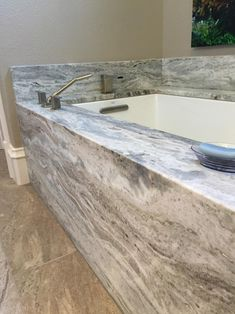 Is this Reality? Yes!  Fantasy Brown Marble Tubhttp://www.arizonatile.com/FANTASY-BROWN-P1505C129.aspx