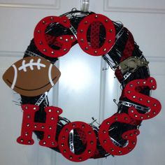 I made this from an idea I found on here. I just spray painted the wreath black. I found all of the items except for the hog @ our local craft store. The letters are wooden & I painted them with red acrylic paint. The rhinestones are self adhesive. I hot glued the ribbon, letters, & football onto the wreath. The hog is actually a car decal that wouldn't stick well to my car, so I also hot glued it on.