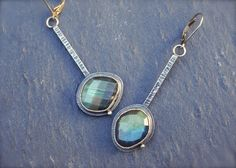 ForestBook via Etsy.  Metalwork, one of a kind mismatched rose cut labradorite earrings in sterling silver.