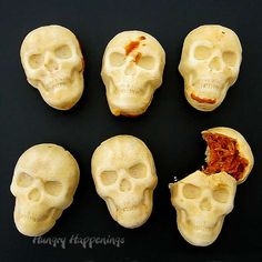 Crispy skull shaped homemade tortillas filled with chicken, cheese & enchilada sauce. These Enchilada Skulls are perfect for Dia de los Muertos & Halloween.