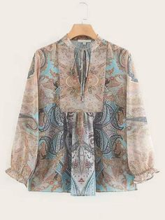 To find out about the Tie Front Paisley Print Blouse at SHEIN, part of our latest Blouses ready to shop online today! Stylish Dress Designs, Stylish Dresses, Casual Dresses, Batik Fashion, Hijab Fashion, Fashion Outfits, Blouse Batik, Printed Blouse, Blouse Styles