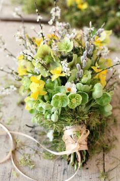 I love this very early spring bouquet! Most of these flowers don't grow here but I can imagine it with local wildflowers, herbs, and blooming shrubs. For vase bouquets as well as for brides.