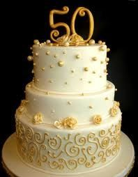 50th anniversary cake in white and gold