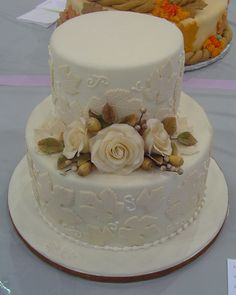 Beautiful Fall tiered cake with handmade gumpaste roses