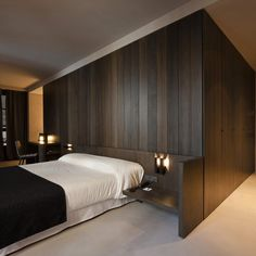 A guest bedroom in Valencia, Spain's Caro Hotel. Design by Francesc Rifé Studio. Photo by Fernando Alda.