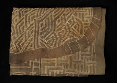 This appliquéd dance skirt in a gorgeous taupe color is from the Kuba, D.R. Congo. The design moves from very complex at the curved end to much more open space at the rectangular end