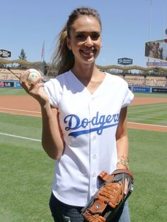 Year in celeb photos 2014: Jessica Alba throws the first pitch at Dodgers Stadium in Los Angeles on Aug. 17, 2014.