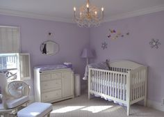 Natalie, How do you like this purple nursery?  Check out the chandalier.  Very feminine.  You could add a pale lavender or white tulle skirt on the bed.