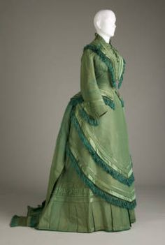Wedding dress, 1874. Silk satin, taffeta. Maker unknown. Gift of Messrs. Charles B., Frank S., and Robert D. Elder.