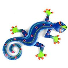 This gecko is handmade in Haiti from recycled oil drums. Each has a small hook to hang the piece and is painted with a bright colorful design inspired by the local Haitian culture. From head to tail, the gecko is 8 inches long. Hanging Wall Art, Metal Wall Art, Wall Hangings, Painted Rocks, Hand Painted, Painted Metal, Cultural Crafts, Arte Country, Oil Drum
