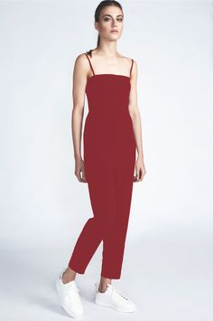 Open back crepe jumpsuit. Can be worn and styled in multiple ways with or without straps. Comes out of the black& white striped C-ya Bag. Red