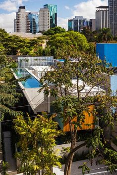 Weekend House in Downtown São Paulo / SPBR. Raised lap pool at the top of the house. There's some serious engineering going on here. Pinned to Pool Design by Darin Bradbury of BASK Pool Design.