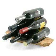 Cute wine holder for the table or in the kitchen. Made from reclaimed fir stumps. Available in our store - click on link.