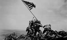 Flag raising on Iwo Jima. February 23, 1945. Joe Rosenthal, Associated Press. (Navy) From the crest of Mount Suribachi, the Stars and Stripes wave in triumph over Iwo Jima after U.S. Marines had fought their way inch by inch up its steep lava-encrusted slopes.  Ca.  February 1945.
