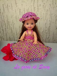 Beaded doll dress by Suzy.