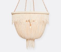 CARMEN: Coco beads are loosely draped and gathered in this glamorous chandelier. #madegoods #chandelier #homedecor