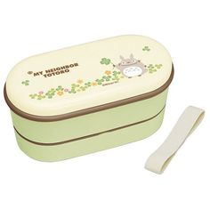 A great two-tiered bento set with bottom lid and chopsticks featuring Totoro from the wildly popular My Neighbor Totoro anime. This is a very well made sealing bento that will fit nicely into your bag or compartmentalized lifestyle because of its handy vertical arrangement. Includes elastic strap...