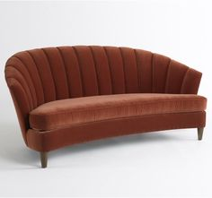Classy curved settee from Dwell Studio. (I'd choose the smoke color.)