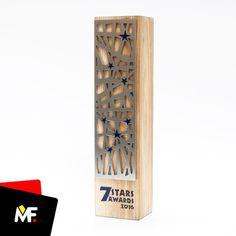 Elegant trophy made of wood with original metal plate.