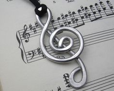 Big but light weight because it is aluminum.  Big Treble Clef  Pendant Necklace for the by nicholasandfelice, $ 12.00