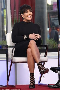 All smiles: Wearing a pair of black lattice high heeled sandals, she showed off her toned ...