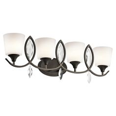 Featuring stunning cut and polished faceted crystals, this 4 light bath light from the Casilda Collection is a decorating coup for the updated traditional lifestyle that inspired it. The crystals dazzle alongside the Olde Bronze finish while the Silver Beige fabric shades and satin etched diffusers complete the look. http://lightingspecialists.com/brand-kichler/bath-4lt/45373oz/sku-LUTH7
