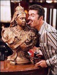 George Michael sticking his tongue out at Queen Victoria, former queen of the United Kingdom.