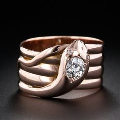 Victorian Coiled Snake Ring,This slithery stylish snake ring wraps around your finger four times and glitters with a .50 carat European cut diamond and tiny rose cut diamond eyes. British Hallmarks.