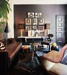 An Elegantly Moody Bachelor Pad. living room. apartment living. home decor and interior decorating ideas. picture arrangements. art.