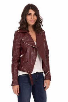 This vegan leather jacket by Comme Toi is the perfect edgy layer. Shiny…