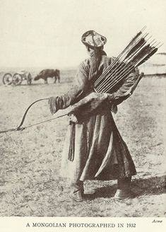 A Mongolian archer, 1932. Photographed from behind so you can really see the quiver and arrows. The bow's a little haeder to make out. In the background is an ox/water buffalo and a cart.