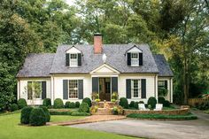 """Little was wrong with this Cape Cod-style cottage—except that it could better reflect its Southern locale. The young home-owners wanted to give their house more character and local flavor but without hampering its good points: charming proportions, high-end materials, and sturdy hardscaping. They turned to architects Paul Bates and Jeremy Corkern, and all agreed to a few improvements. """"The home was already very stylish,"""" says Jeremy. """"It just needed some simplifying and rescaling."""" A new…"""