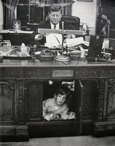Here, the two-year-old tot plays under Kennedy's desk in the oval office. Description from pinterest.com. I searched for this on bing.com/images