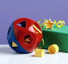 Shape Sorter Toy.  Tupperware.  (my mom sold tupperware when i was little; we still have a bunch of the vintage stuff in olive green, orange and harvest gold. and brown. LMAO)