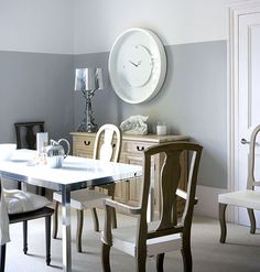 Fashionable Curves Mix a sleek, modern table with curvaceous chairs. Add depth with two-tone walls.