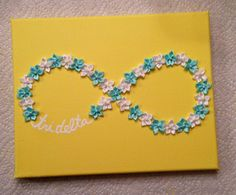 Craft for my tri delta little! Hot glue flowers onto a painted canvas.