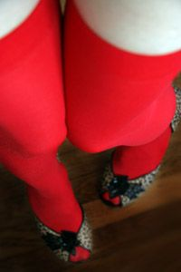 Solid Opaque Thigh High - They'll stay up on their own, but look really cute with garters attached too.  As often happens with these styles, this one tended to be more mid thigh, they may even be just over the knees on longer or wider legs.  They are fairly opaque and quite soft with nice bright true colors.