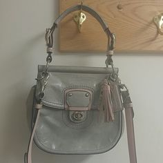 I'm selling because I just never carry it. This is a Coach bag bought online from Coach. Lightly used no major issues just a little bit of dye rub off from a shirt on the strap. No pen marks or stains on the inside. Coach Bags Crossbody Bags