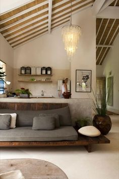 relaxed chic setting would be great in a cabin love the white wood beams against the natural