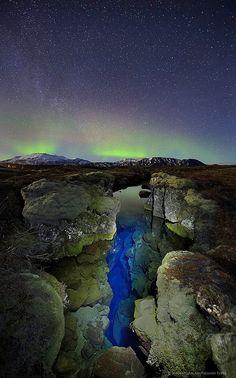 Þingvellir Iceland aurora borealis over Silfra crack by Wildernesscapes Photography, via Flickr