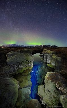 Þingvellir Iceland aurora borealis over Silfra crack by Wildernesscapes Photography, via Flickr