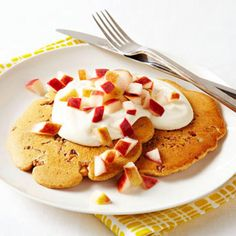 Apple-Walnut Pancakes with Brown Sugar Yogurt.Mix 1/4 cup whole-grain pancake mix with water according to package directions. Stir in 1 tablespoon chopped walnuts. Heat a medium skillet  and coat with nonstick cooking spray. Pour batter into skillet to make two 5-inch pancakes; cook 2 minutes a side. Meanwhile, combine 1/2 cup low-fat plain Greek yogurt with 2 teaspoons brown sugar. Top pancakes with yogurt mixture and 1/2 cup chopped apple