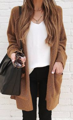 A brown cardigan white top + pants + bag