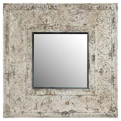 Add an elegant touch to your entryway or powder room decor with this eye-catching wall mirror, showcasing an intricate scrolling motif and antiqued white met...