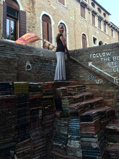 Bookstore in Venice that was once flooded. The damaged books are now used as staircases.
