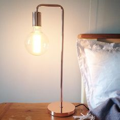 add a touch of copper to your bedside table. we love the junction table lamp