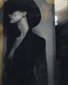 A Polaroid by Diego Uchitel. Fashion. Femme Fatale. Black and White. Photography. Hat. Beauty. Mysterious.