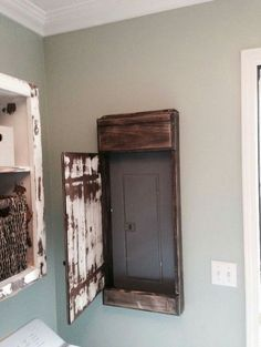 Put a mirror on the front of the distressed wood to make it purposeful