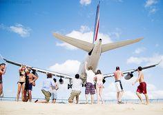 Beachgoers at St. Maarten's Maho Beach get a rush as Air France flight 488 from Paris passes over their heads at Princess Juliana Airport.