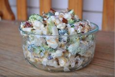 Amish Broccoli Salad... This is to die for... 1 head broccoli, chopped 1 head cauliflower, chopped 1 cup mayonnaise 1 cup sour cream 1/2 cup sugar (substitute, for low carb) 1/2 teaspoon salt 1/2 pound bacon, fried and crumbled 1 cup shredded Cheddar cheese